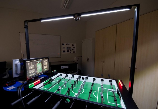 A white LED stripe illuminates the soccer field. A webcam mounted on top allows to record matches and stream them into the internet.